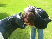 Juanita gets cosy with a calf.